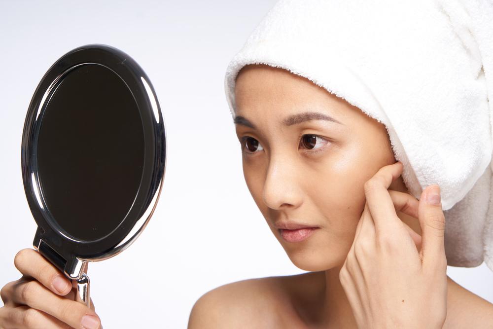 asian woman portrait mirror