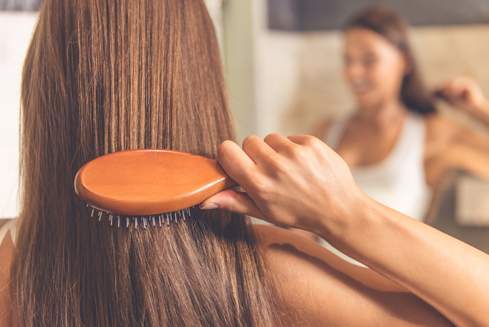 A woman brushing her hair.