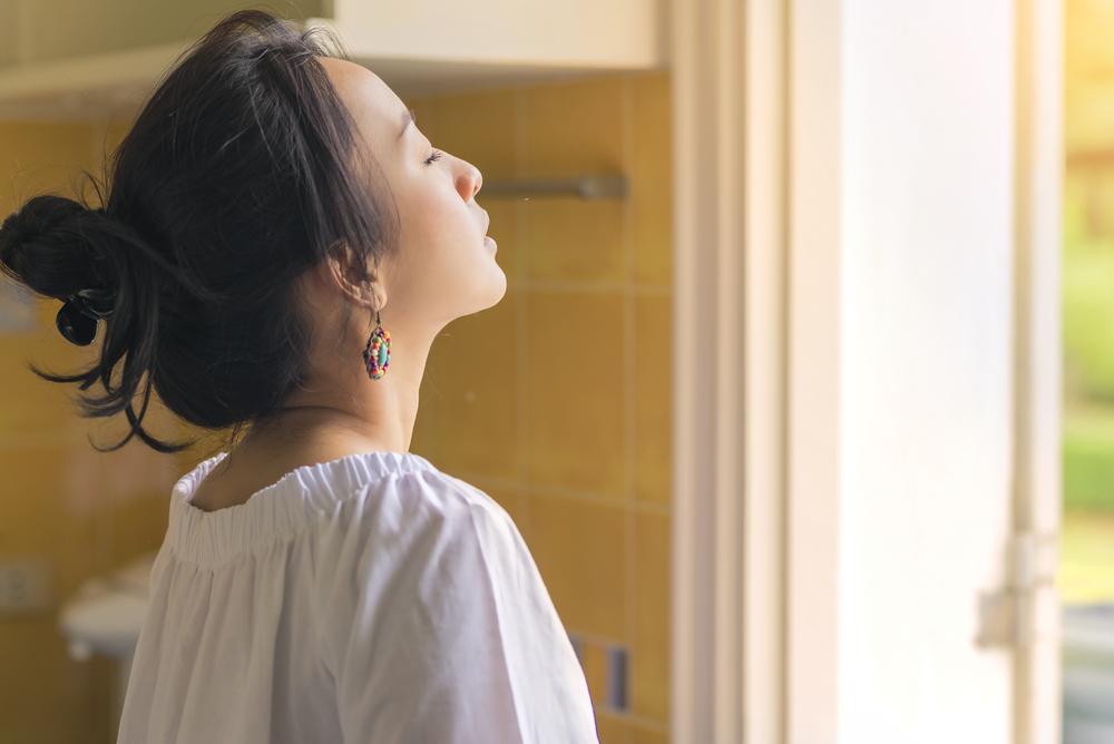 Beautiful woman breathing fresh air