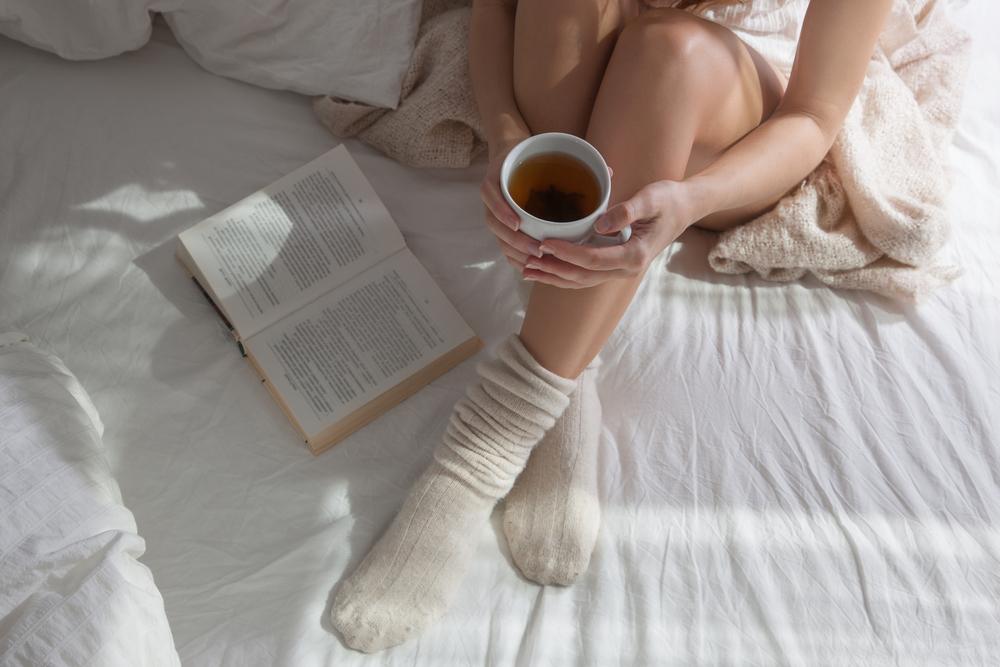 Woman wearing socks in bed
