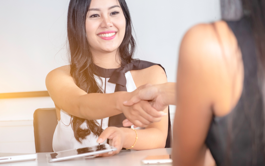 Business women handshake with boss after her show work report that good performance.