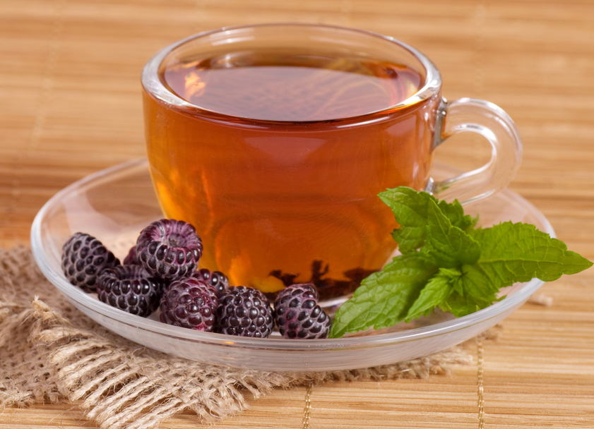 Fruit tea(tea package) in cup with blackberry