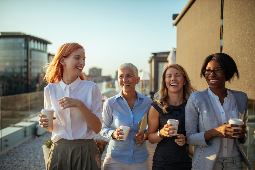 Happy business women having coffee