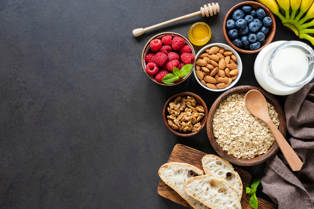 A display of foods sit on a black background.