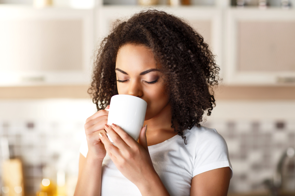 Beautiful woman drinking tea.