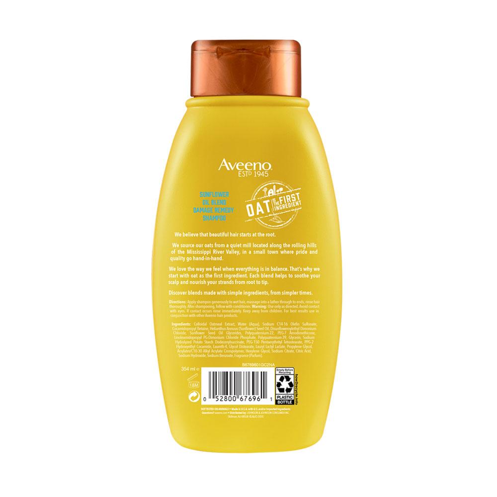 Parte posterior de la botella de Aveeno® Sunflower Blend Shampoo