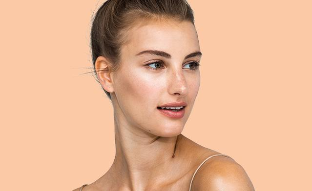 closeup of woman with radiant skin care and neutral makeup