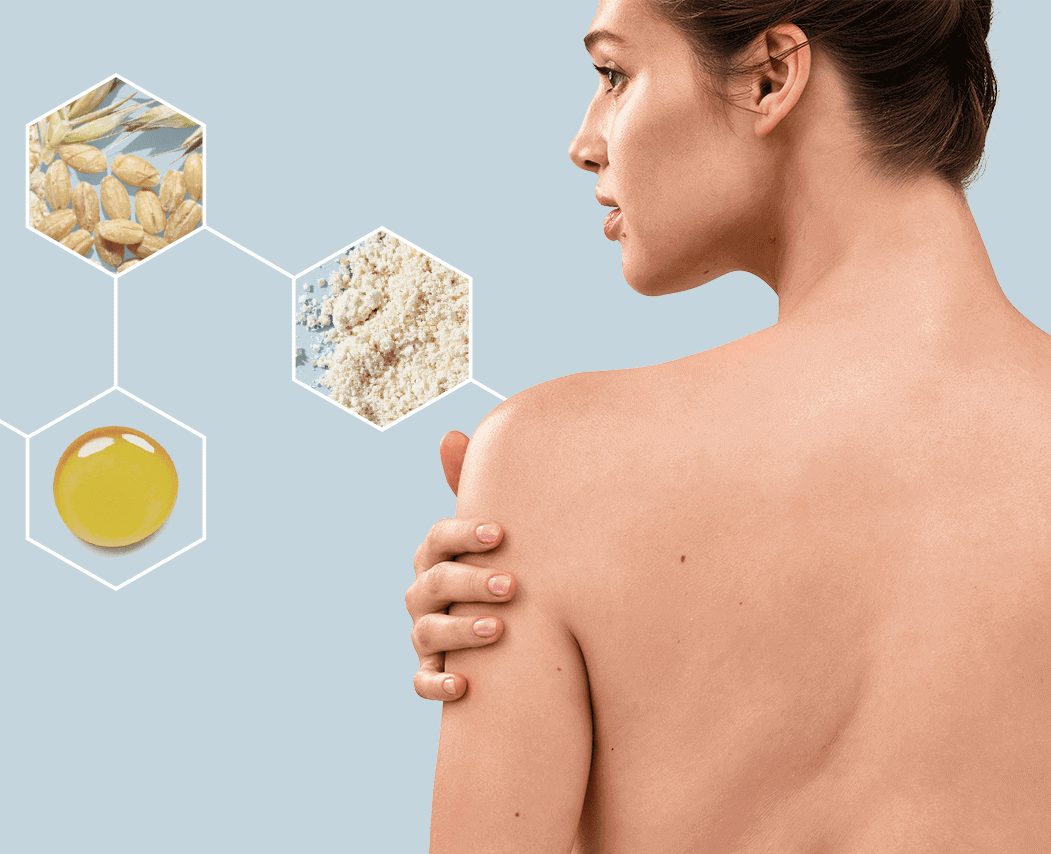 Woman looking at Microbiome with Oat Skincare ingredients