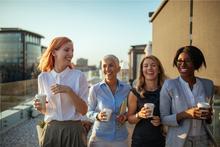 Happy business women having coffee