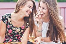 Happy woman talking to a friend.