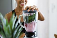 Woman blending a smoothie.