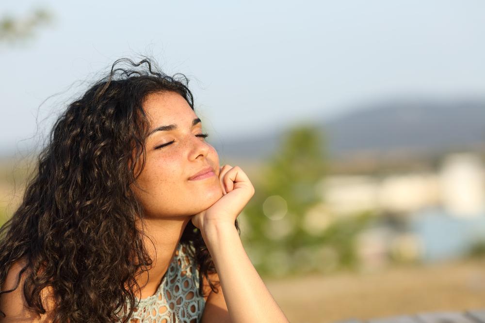 Woman relaxing enjoying the warmth of the sun